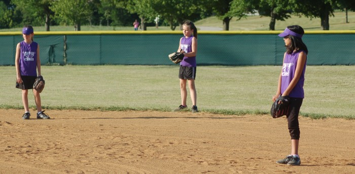 Kylie Mabley, Susan Baird, and Bella Lytle make up the right side of the infield and outfield of the 2012 Pumas softball game
